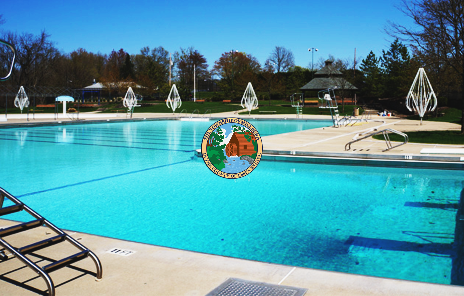 Photograph of Millburn Town Pool with Township of Millburn Seal in center of image