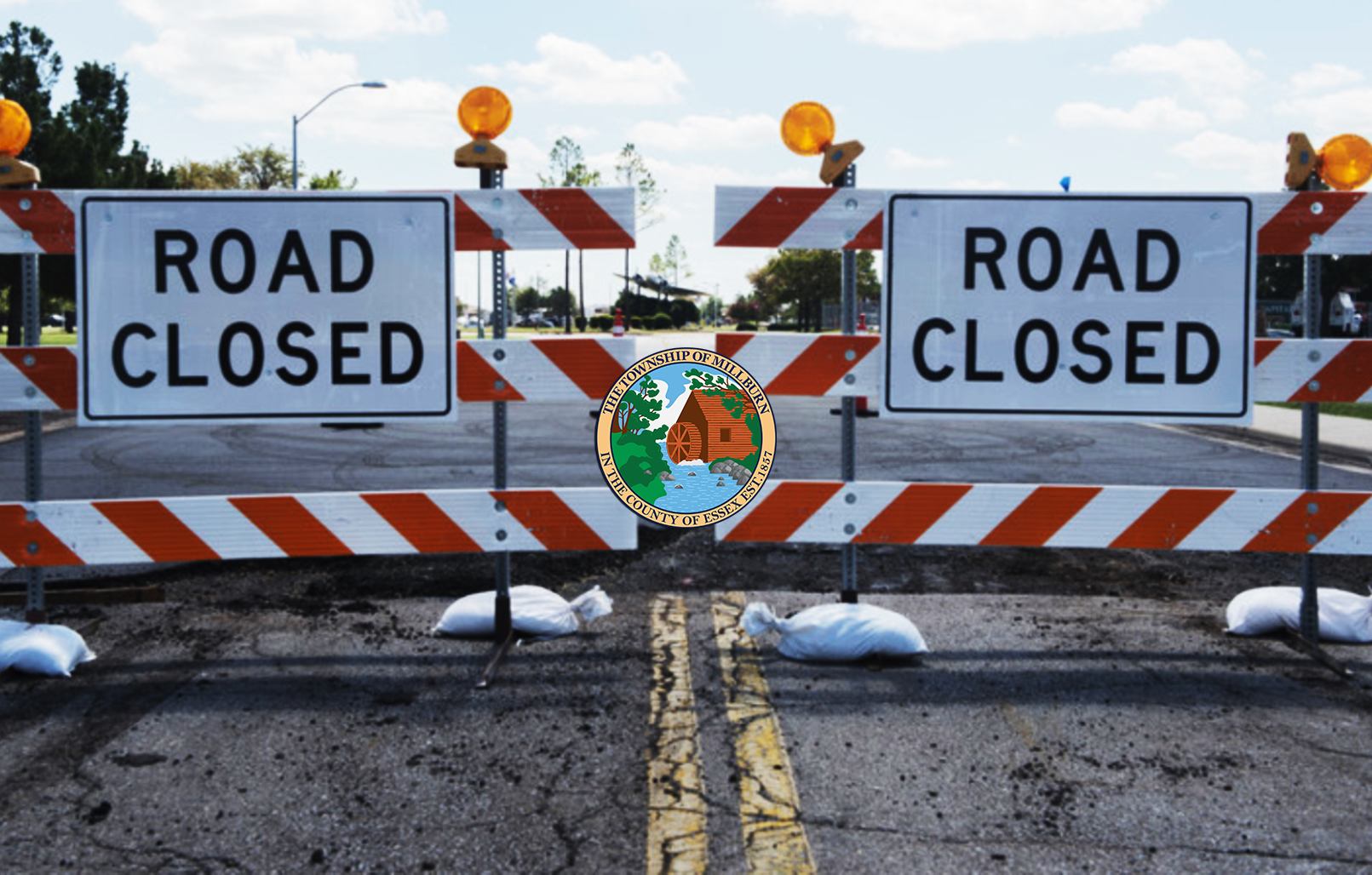 Image of road blocks with signs that say &#34Road Closed&#34