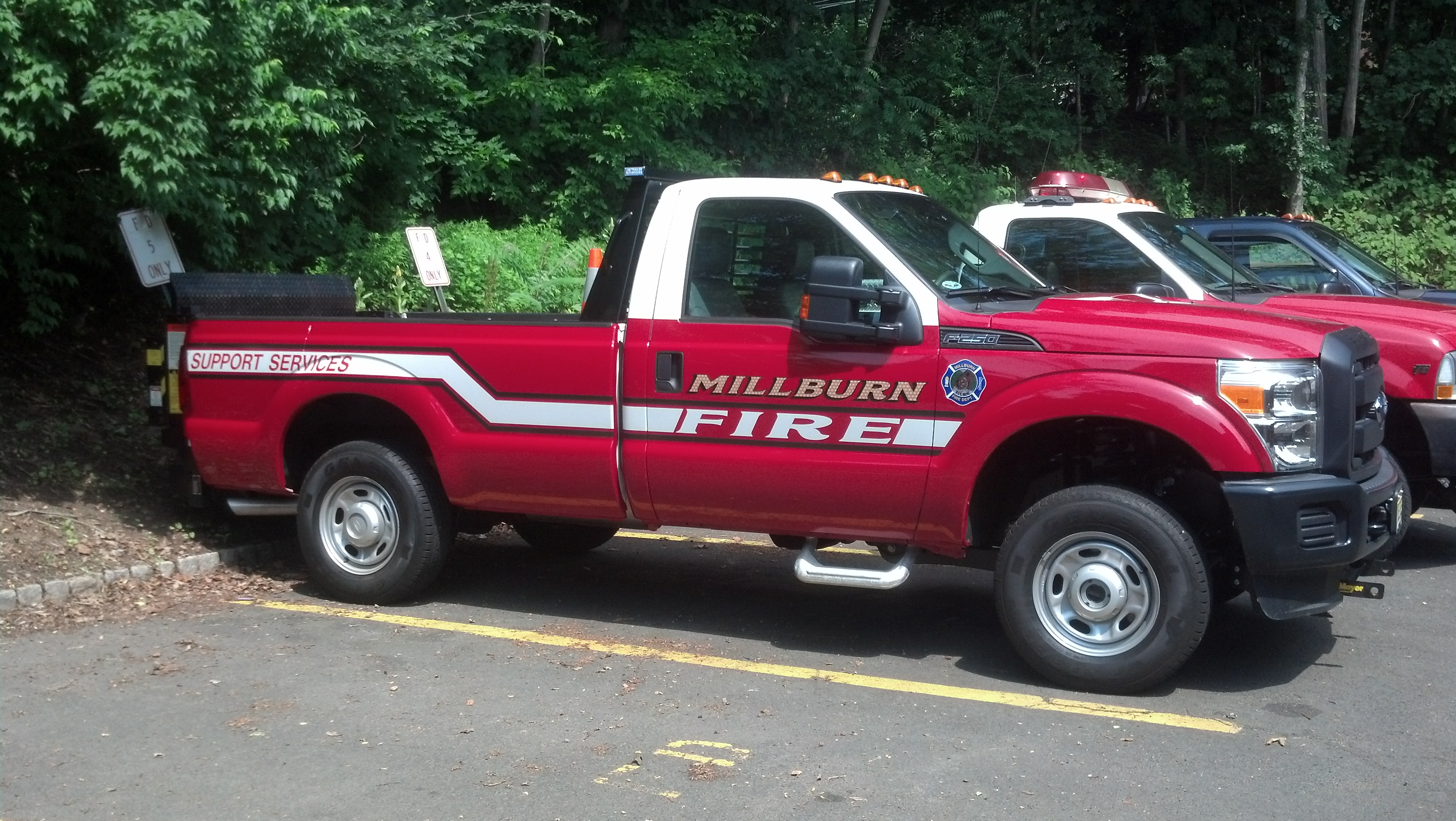 A red pickup truck with Millburn Fire on the side