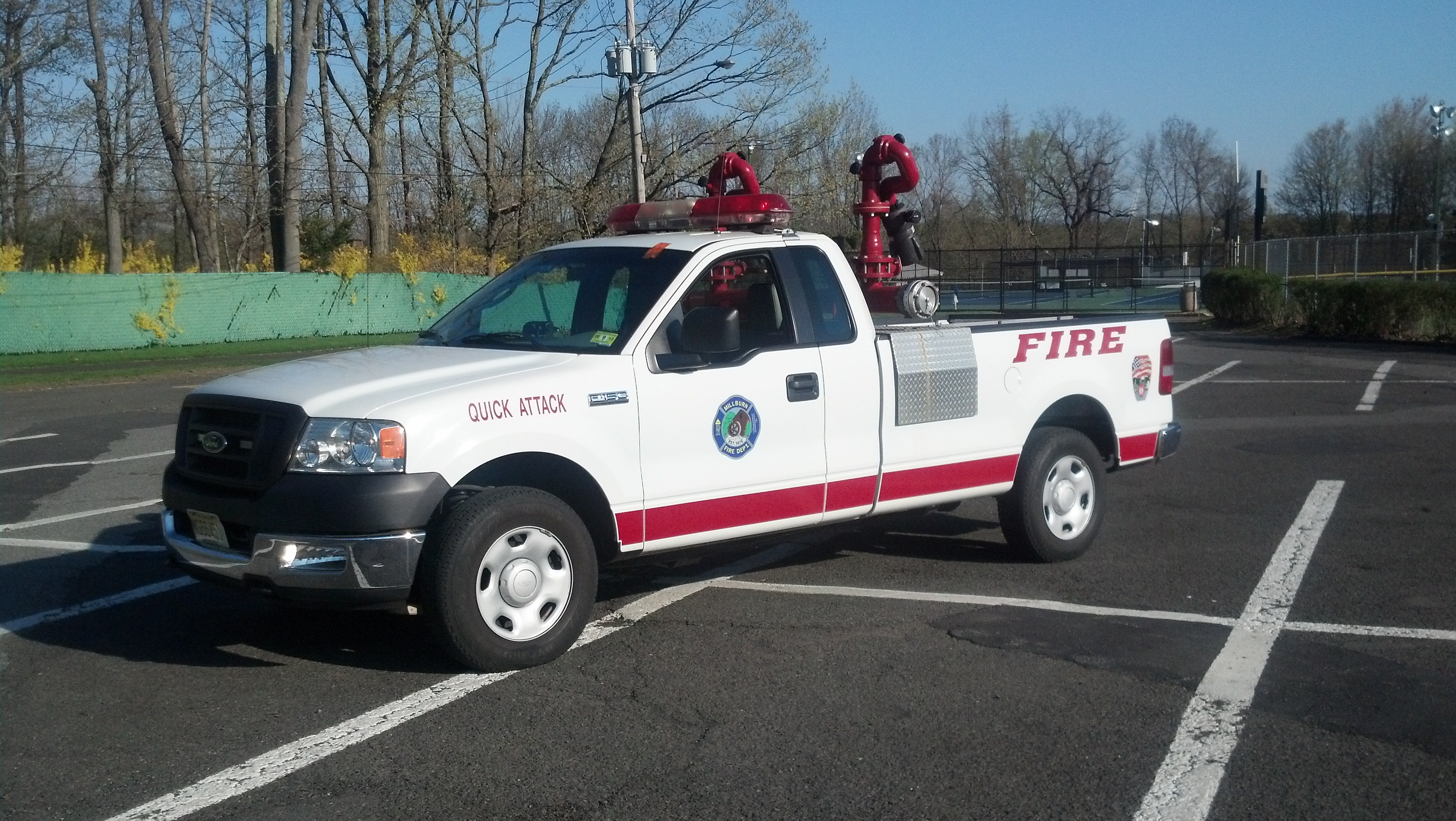 A white and red quick attack truck with large red