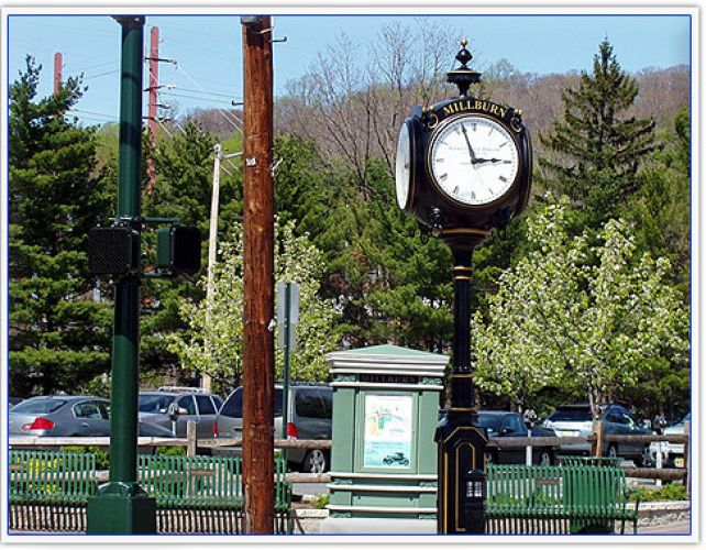 A street post style clock with Millburn on it